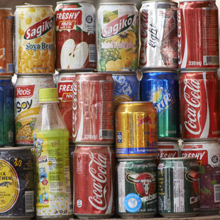 Old soft drink can's put up for show