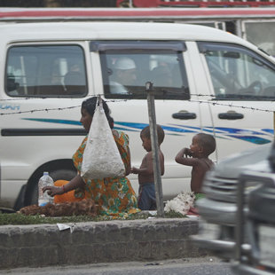Desperation - family making a living in the trafic jam, Dhaka Bangladesh 2015