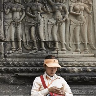 Chines visitor with her smart phone, Angkor Wat
