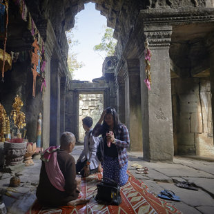 Female preast gives blessings, Angkor Wat