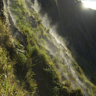 Hot steam shows on the inside the crater of activ Batur, Bali