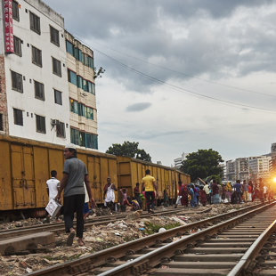 Raliways is a rear but cheap way of transport. Trains runs slow through this slum area.