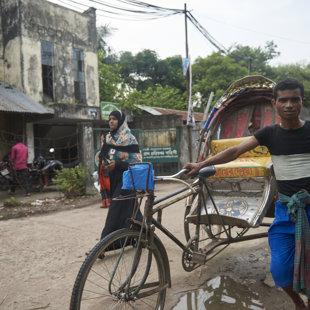 Richaws acros from a policestation, Koral Slum, Dhaka